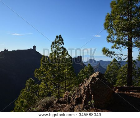 Mountain landscape with pines and blue sky, Roque Nublo and Roque Bentayga, summit of Gran Canaria, Canary Islands, Spain stock photo