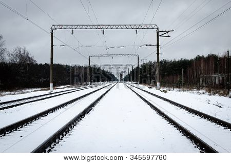Railroad tracks in winter. The image of a winter view of the railroad tracks. Background of train tracks in winter. stock photo