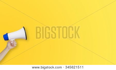Business Communication and Marketing Concept : Female hand holding megaphone for announcement and advertisement. stock photo
