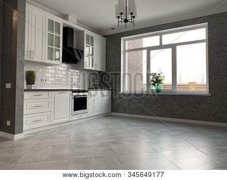 White kitchen furniture with black countertops. New modern kitchen with hood and sink. Interior design kitchen studio, minimalism or classic. stock photo