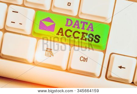 Handwriting text Data Access. Concept meaning a user s is ability to access data stored within a database White pc keyboard with empty note paper above white background key copy space. stock photo