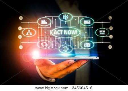 Word writing text Act Now. Business concept for fulfil the function or serve the purpose of Take action Do something Male human wear formal work suit presenting presentation using smart device. stock photo