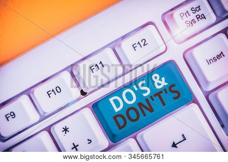 Handwriting text writing Do S And Don T S. Concept meaning Confusion in one s is mind about something White pc keyboard with empty note paper above white background key copy space. stock photo