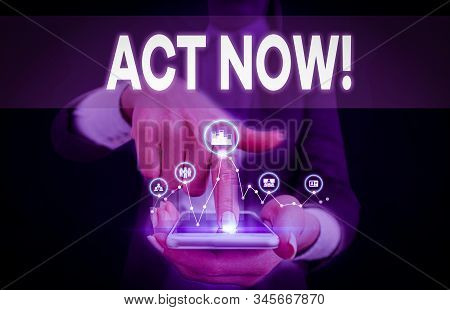Conceptual hand writing showing Act Now. Business photo text fulfil the function or serve the purpose of Take action Do something Woman wear work suit presenting presentation smart device. stock photo