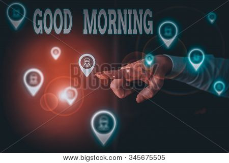 Writing note showing Good Morning. Business photo showcasing expressing good wishes on meeting or parting during the morning Woman wear formal work suit presenting presentation using smart device. stock photo