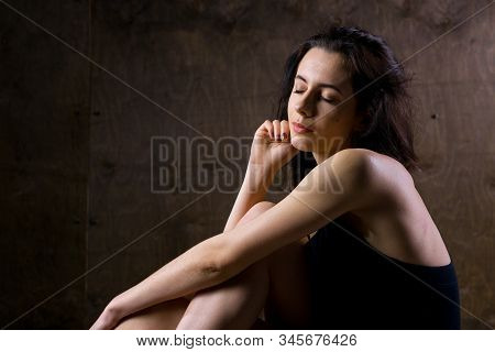 Abstract and stress emotional concept. depressed girl in lonely mood, theme of stressful. Sad woman sitting alone in empty room. Depression and chronic fatigue. female having psychological trauma stock photo
