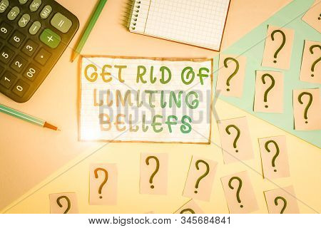 Handwriting text Get Rid Of Limiting Beliefs. Concept meaning remove negative beliefs and think positively Mathematics stuff and writing equipment above pastel colours background. stock photo