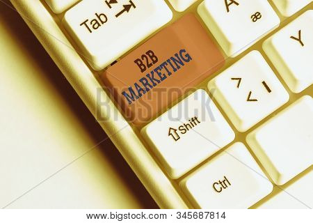 Word writing text B2B Marketing. Business concept for Partnership Companies Supply Chain Merger Leads Resell White pc keyboard with empty note paper above white background key copy space. stock photo