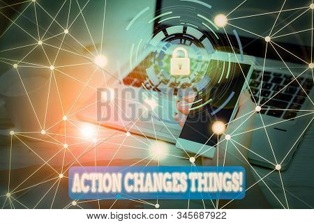 Text sign showing Action Changes Things. Conceptual photo start doing something against problem resolve or achieve it Picture photo system network scheme modern technology smart device. stock photo