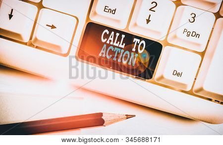 Text sign showing Call To Action. Conceptual photo Encourage Decision Move to advance Successful strategy White pc keyboard with empty note paper above white background key copy space. stock photo