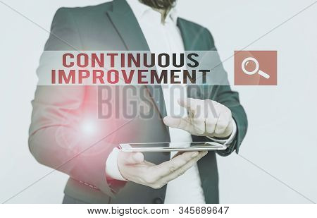 Text sign showing Continuous Improvement. Conceptual photo ongoing effort to improve products or processes Businessman with pointing finger in front of him. stock photo