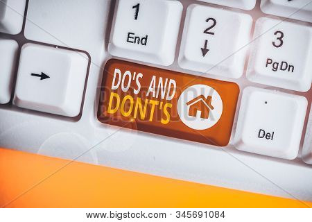 Handwriting text Do S And Dont S. Concept meaning Rules or customs concerning some activity or actions White pc keyboard with empty note paper above white background key copy space. stock photo