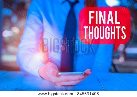 Writing note showing Final Thoughts. Business photo showcasing the conclusion or last few sentences within your conclusion Female business person sitting by table and holding mobile phone. stock photo