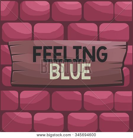 Handwriting text Feeling Blue. Concept meaning Feeling of desperation because of sadness or missing someone Plank wooden board blank rectangle shaped wood attached color background. stock photo