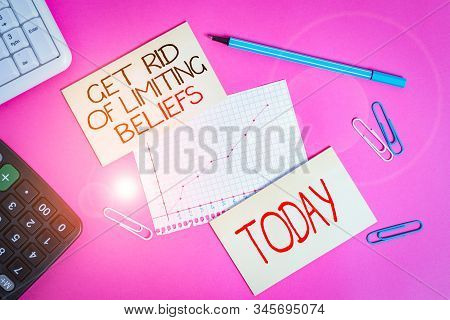 Conceptual hand writing showing Get Rid Of Limiting Beliefs. Business photo text remove negative beliefs and think positively Writing equipments and computer stuff placed on plain table. stock photo