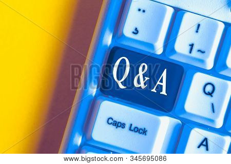 Handwriting text Q And A. Concept meaning defined as questions being asked and answers White pc keyboard with empty note paper above white background key copy space. stock photo