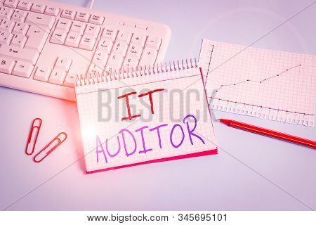 Conceptual hand writing showing It Auditor. Business photo showcasing demonstrating authorized to review and verify the accuracy of the system Paper blue keyboard office study notebook chart numbers memo. stock photo