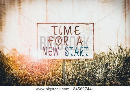 Text sign showing Time For A New Start. Conceptual photo Trust the magic of Beginnings Afresh Anew Rebirth Crumpled paper attached to a stick and placed in the green grassy land. stock photo