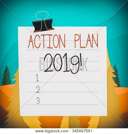Word writing text Action Plan 2019. Business concept for proposed strategy or course of actions for current year Paper lines binder clip cardboard blank square notebook color background. stock photo
