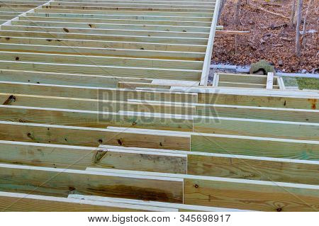 New deck patio with modern wooden deck installing wood floor for patio stock photo