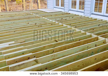 Fragment planks installing wood floor for patio deck with new wooden decking stock photo