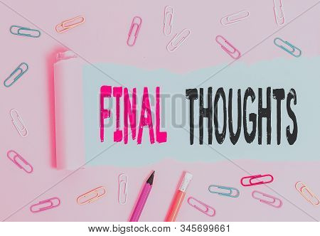 Handwriting text writing Final Thoughts. Concept meaning the conclusion or last few sentences within your conclusion Stationary and torn cardboard placed above a plain pastel table backdrop. stock photo