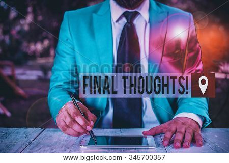 Word writing text Final Thoughts. Business concept for the conclusion or last few sentences within your conclusion Businessman holds pen and points into copy space. stock photo