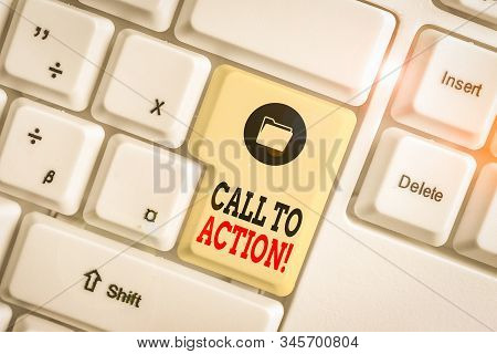 Text sign showing Call To Action. Conceptual photo exhortation do something in order achieve aim with problem White pc keyboard with empty note paper above white background key copy space. stock photo
