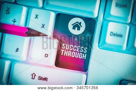 Text sign showing Success Through Persistence. Conceptual photo never give up in order to reach achieve dreams White pc keyboard with empty note paper above white background key copy space. stock photo