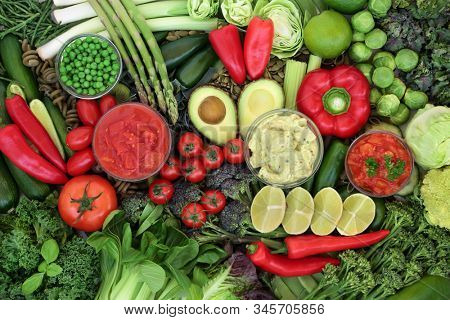 Low glycemic health food for diabetics with green & red vegetables & fruit high in vitamins, minerals, antioxidants, anthocyanins, smart carbs & omega 3 fatty acids. Below 55 on the GI index.   stock photo