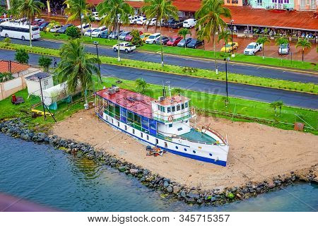 Colon is a sea port on the Caribbean Sea coast of Panama. The city lies near the Caribbean Sea entrance to the Panama Canal. stock photo
