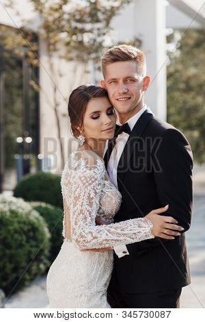 Loving couple at the hotel on a honeymoon.Just married. Honeymoon concept. Romantic relations. True love. Family love. Couple in love. Cute relationship. Man and woman cuddle nature background.  Together forever. Love story of the newlyweds. stock photo