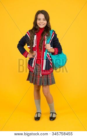 trendy school uniform. learning languages. british school in england. vacation in great britain. travel concept. small girl uniform hold backpack. kid with english flag on jacket. go study to england. stock photo