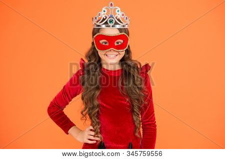 Success is state of mind. Happy girl enjoy success orange background. Little child being excited about success. Small kid wear carnival mask. Crown of success. Successful and proud. stock photo