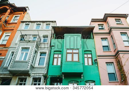 Ancient traditional apartment buildings in the Balat district of Istanbul in Turkey. The houses in this area were built in the 15-18 centuries, not later. stock photo