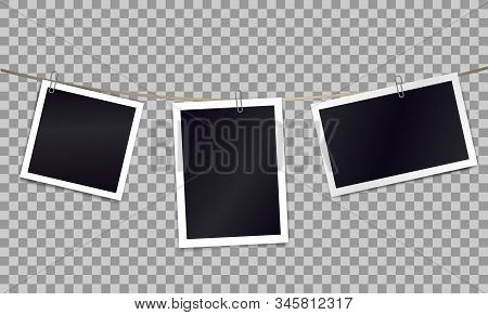 Three photorealistic blank retro photo frames attached metal paper clips on tape. Template for design. Vector illustration. stock photo