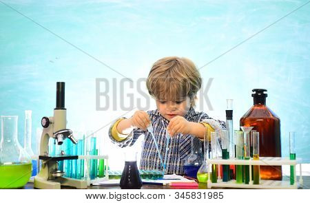Little kids scientist earning chemistry in school lab. Knowledge day. School chemistry lessons. First grade. Chemistry The Science Classroom. Little children at school lesson. stock photo