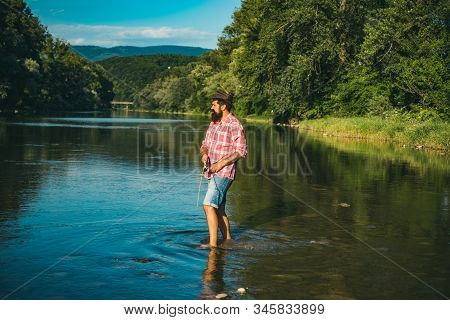 Fisher masculine hobby. Bearded and elegant man. It is not sport it is obsession. I am happiest man. Hunting. Perfect weekend. Relaxing while enjoying hobby stock photo