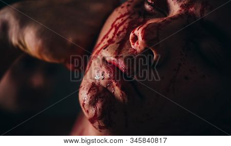 Body soiled blood. Prison for monster. Psycho mad man. Psychic disease. Murderer brutal aggressive guy. Halloween concept. Aggressive person. Injured soldier. Pain and injury. Aggressive monster. stock photo