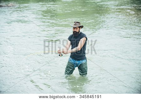 Man bearded fisher. Weekend time. Carry on fishing. Portrait cheerful man. Weekends made for fishing. Activity and hobby. Fly fishing adventures. Home of hobbies. Fisherman with fishing rod stock photo