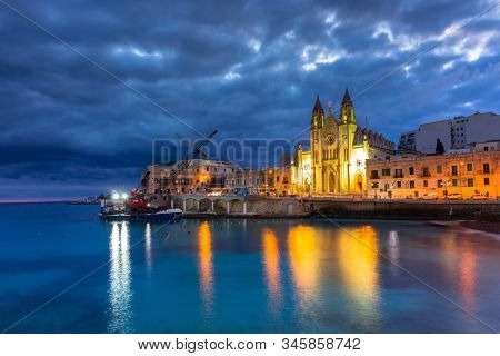 Beautiful church at St. Julians bay at dawn, Malta stock photo