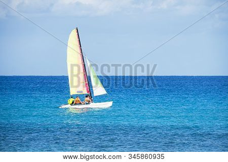 Sailing boats in the beautiful cuban beach of Varadero. A sailing ship transports tourists across the blue sea in good weather. tourist catamaran. eco transport stock photo