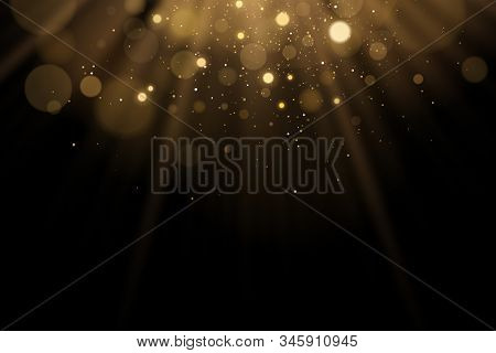 Golden flash of light with glares bokeh on a black background. Rays of light with glitter. Vector illustration. EPS 10 stock photo