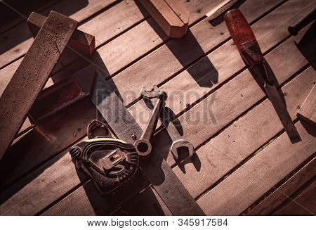 Carpenter tools on workbench. Carpentry work with old tools. DIY equipment for carpenter. Woodwork  workshop. Woodwork on vintage background. Old chisel, tape measure, and wrench on wooden bench. stock photo