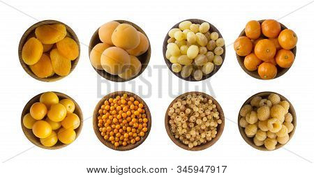 Yellow berries/fruits isolated on white background. Collage of different yellow berries. Yellow currants, yellow raspberries, grapes, apricots, sea buckthorn, tangerines and plums. Top view. Fruits with copy space for text. stock photo