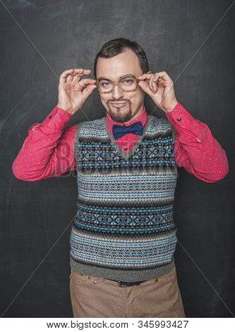 Angry business man or teacher on blackboard background stock photo