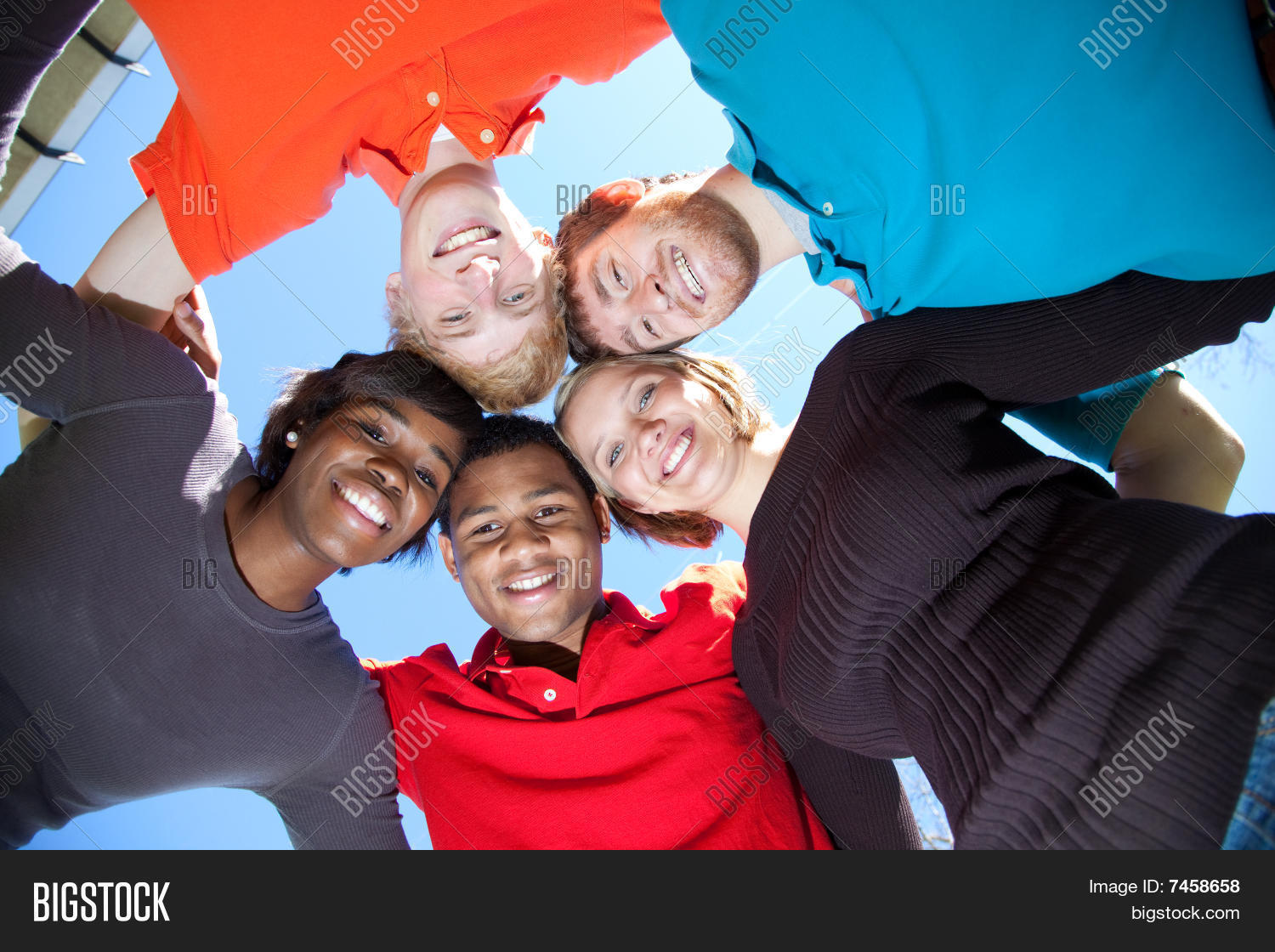 Faces Of Smiling Multi-racial College Students