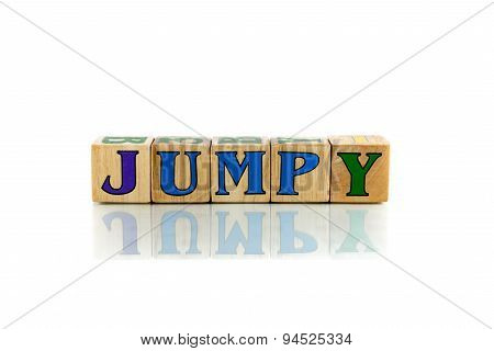 jumpy colorful wooden word block on the white background stock photo