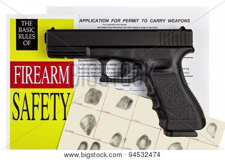 Pistol Handgun with Firearm Application and Concealed Weapons Permit CCW with Fingerprint ID stock photo
