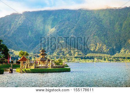 Pura Ulun Danu Bratan, Hindu temple surrounded by water of Bratan lake and high green mountains, Indonesia. Asia landmark. Major Shivaite temple of Bali island.